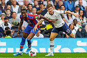 Crystal Palace forward Wilfried Zaha (11) and Tottenham Hotspur defender Ben Davies (33) during the Premier League match between Tottenham Hotspur and Crystal Palace at Tottenham Hotspur Stadium, London, United Kingdom on 14 September 2019.