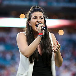 July 31, 2018 - Miami Gardens, Florida, USA - Isabella Pena sings the US National Anthem during the opening ceremony of an International Champions Cup match between Real Madrid C.F. and Manchester United F.C. at the Hard Rock Stadium in Miami Gardens, Florida. Manchester United F.C. won the game 2-1. (Credit Image: © Mario Houben via ZUMA Wire)