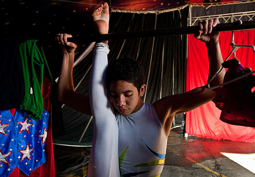"Kevin Zandrac, 15, from Colombia, stretches before a performance on Thursday, March 26, 2009, in a suburb of Dallas, Texas. Zandrac has been a contortionist in the Carson & Barnes Circus since he was an infant while his father Julio is the head tent engineer. Doctors have told him to stop contorting his body so extremely because eventually it will lead to long-term joint problems. ""I want to be in Cirque Du Solei so I don't care what the doctors think,"" Zandrac said."