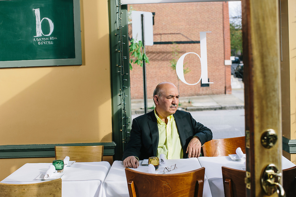 Qayum Karzai, the older brother of Afghanistan's longtime president Hamid Karzai spends time at b - A Bolton Hill Bistro, one of three restaurants he and his family own in Baltimore, Md. Karzai splits his time between the United States and Afghanistan, running the restaurants in Baltimore while helping govern his home country. CREDIT: Greg Kahn/GRAIN for The Wall Street Journal   SLUG: KARZAI