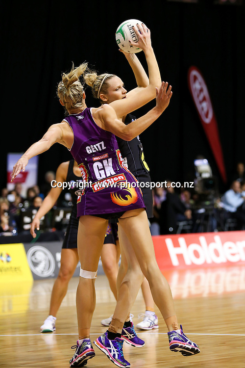 Queensland Firebird captain Laura Geitz and Waikato BOP Magic's Jo Harten in action during the ANZ Championship netball match - Waikato BOP Magic v Queensland Firebirds at Claudelands Arena, Hamilton, New Zealand on Monday 2 June 2014.  Photo:  Bruce Lim / www.photosport.co.nz