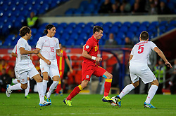 Gareth Bale of Wales (Real Madrid) dribbles through the Serbian defence during the second half of the match - Photo mandatory by-line: Rogan Thomson/JMP - Tel: Mobile: 07966 386802 10/09/2013 - SPORT - FOOTBALL - Cardiff City Stadium - Cardiff -  Wales V Serbia- World Cup Qualifier.