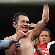 """Glen Donaire of the Philippines celebrates his victory of the WBC Latin Flyweight Title at the Kissimmee Civic Center in Kissimmee, Florida, on Friday, Dec 9, 2011.  Donaire won the bout when Alex """"El Nene"""" Sanchez injured his left wrist and failed to come out in the ninth round. (AP Photo/Alex Menendez)"""