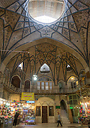 Stunning photographs reveal the beautiful ceilings in Iran's mosques, bazaars and public baths<br /> <br /> For the past few decades, restrictions on travel to Iran has meant the country has been largely shut off from the Western world, but as visa sanctions are lifted in the light of a landmark nuclear deal, the local tourism industry is hoping for a flurry of visitors.<br /> It's not hard to see why Iran is listed as one of the top travel destinations of 2016, with its rich culture and history. <br /> Among the standout aspects of the nation is its beautiful ancient architecture, with the cities and towns littered with ornate and eye-catching mosques, public baths and markets. <br /> And unlike many other countries - the roof is not an afterthought, with many ceilings built as the centrepiece to the building, with many of the tile designs showcasing a display of intricate geometric patterns that date back several centuries. <br /> French photographer Eric Lafforgue has travelled the country photographing the ceilings of indoor markets, mosques and bath houses. <br /> <br /> Photo shows: The Grand Bazaar Tehran is an old historical market in the capital that is split into several corridors over six miles in length, each specialising in different types of goods