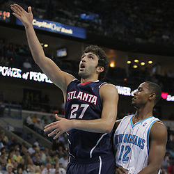05 November 2008: Atlanta Hawks center Zaza Pachulia (27) drives past New Orleans Hornets center Hilton Armstrong (12) during the first half of a NBA game between the New Orleans Hornets and the Atlanta Hawks at the New Orleans Arena in New Orleans, LA..