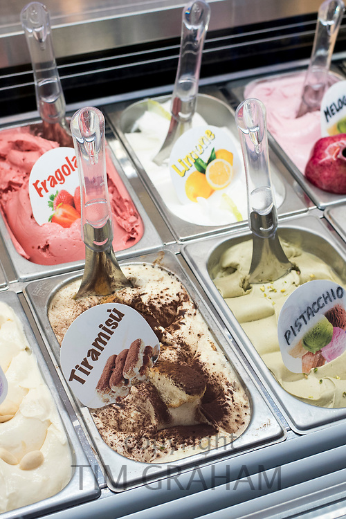 Traditional artisan gelato ice cream - lemon, pistachio, tiramisu, strawberry on sale in Taormina, Sicily, Italy