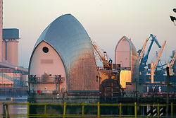 UK ENGLAND WOOLWICH 18DEC03 - General view of the Thames Barrier at Woolwich, south-east London. Built between 1974 and 1984, the structure protects the city of London from surge tides that may flood into London via the mouth of the Thames Estuary. At the Barrier, the 1716 feet-wide river Thames is divided by nine reinforced concrete piers, to form six openings for shipping and four other openings.<br />