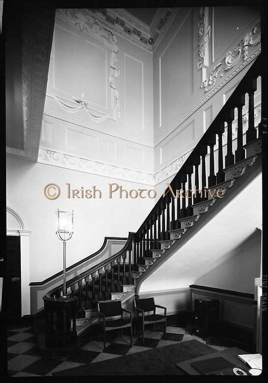 Interior & Exterior of South Leinster Street. (asbestos cement) <br /> 1970.<br /> 14.10.1970.<br /> 10.14.1970.<br /> 14th October 1970.<br /> The Interior and exterior of No 6 South Leinster House.<br /> <br /> The image shows the ornate staircase fronting the ornate wall panels in the house.