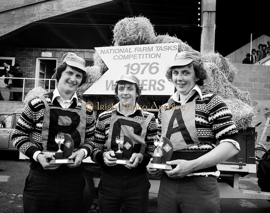 The victorious Tullyallen, Co Louth Macra na Feirme team, Pat Winters, George O'Brien and Gerry Healy, display their trophies after they were declared overall winners of the National Farm Tasks Competition, sponsored by Irish Shell Ltd. Over 400 teams originally took part in the competition.<br />