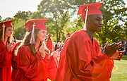 Isaac Bellevue and Ellie Bennett wait to receive their diplomas during the 148th Graduation exercises at Wellesley High School on June, 2, 2017.   [Wicked Local Photo/James Jesson]