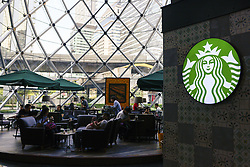 May 25, 2019 - Bangkok, Thailand - Customers use smartphones while sitting in a Starbucks Corp. coffee shop at Shopping Mall, in Bangkok, Thailand, on 25 May 2019. (Credit Image: © Anusak Laowilas/NurPhoto via ZUMA Press)