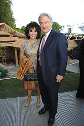 LADY LINDA DAVIES host of the evening and IVAN FALLON chief executive, Independent News & Media at a reception at the gold medal winning De Beers garden in aid of the KT Wong Charitable Trust at the 2nd day of the 2008 Chelsea Flower show on 20th May 2008.<br />