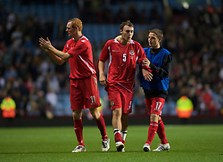 BIRMINGHAM, ENGLAND - Monday, October 13, 2008: Wales' Darcy Blake, Shaun MacDonald and Joe Allen look dejected after losing to England during the UEFA European Under-21 Championship Play-Off 2nd Leg match at Villa Park. (Photo by Gareth Davies/Propaganda)