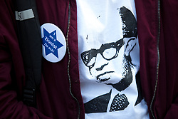 © Licensed to London News Pictures. 26/03/2018. London, UK. Campaigners demonstrate against anti-Semitism in the Labour Party, following an open letter from the Board of Deputies of British Jews and the Jewish Leadership Council to Leader of the Labour Party Jeremy Corbyn. A counter-demonstration by pro-Corbyn Jewish Labour members is also staged nearby. Photo credit : Tom Nicholson/LNP