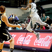 UNCW's Kelva Atkins saves an out of bounds ball Sunday November 16, 2014 at Trask Coliseum in Wilmington, N.C. (Jason A. Frizzelle)