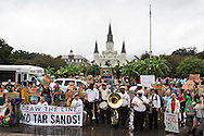 """New Orleans, LA,  September 21, 2013,  The environmental group 350.org's  """"Draw the Line"""" on Tar Sands and the Keystone XL  pipeline  protest  took  the form of a second line parade as it made its way through the french quarter stopping to pose in front of St Louis Cathedral  .Over a hundred participants, including members of <br /> 350 NOLA, The Tulane Green Club , the Bucket Brigade,  and other environmental groups called out to  stop the Keystone XL pipeline as they marched and danced in the streets.  350.org's 'Draw the Line' campaign had over 200 events that took place across the country."""