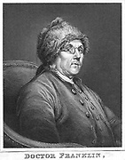 Benjamin Franklin (1706-1790) American scientist and statesman. Wearing bifocal spectacles which he invented in 1775. Engraving