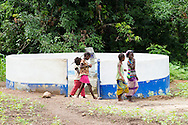 Kids walking by the EU funded well in the Kamanso Village in the Koinadugu District (July 19, 2016).<br /> <br /> This Community is supported by Oxfam GB and Projects are funded by the European Commission. <br /> <br /> Improving the health status of Koinadugu District through equitable water, sanitation and hygiene service delivery: The overall objective of the project is to contribute to the achievement of MDGs 4 and 7, improving health in Sierra Leone. The main problem is to be addressed by this action is the poor health status of the citizens and the link between improved health and increased access to WASH services. The causes of under 5 mortality are related to malnutrition and lack of access to adequate primary health care and infrastructure such as water and sanitation. Small sale delivery of water sanitation infrastructure and hygiene promotion services in order to identify cost-effective approaches and increase access to improved water and sanitation facilities, as well as key hygiene behaviors are among the main approaches. Also the importance of increasing the voice and influence of the communities, but in particular women, in the development planning process for WASH services.