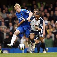Photo: Chris Ratcliffe.<br />Chelsea v Tottenham Hotspur. The Barclays Premiership. 11/03/2006.<br />Damien Duff (L) of Chelsea tackles Edgar Davids.