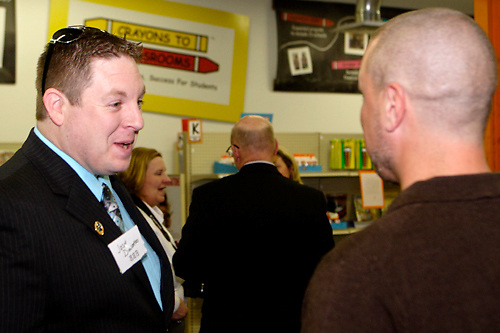 Josh Donohoo of the Better Business Bureau (left) and Brian Brandanburg of World Financial Group during a BBB networking event at Crayons to Classrooms in Dayton, Tuesday, February 28, 2012.