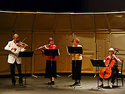 Valley Vivaldi players Simon Maurer, violin, Robin Kani, flute, Cheryl Bishkoff, oboe, and Deborah Davis, cello,  perform in a Sunday evening concert starting at 7:30 PM on June 28, 2009 at Cedar Crest College in Allentown, Pennsylvania, United States.