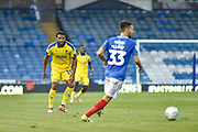 AFC Wimbledon Midfielder, Tom Soares (19) closes down Portsmouth Midfielder, Ben Close (33) during the Carabao Cup match between Portsmouth and AFC Wimbledon at Fratton Park, Portsmouth, England on 14 August 2018.