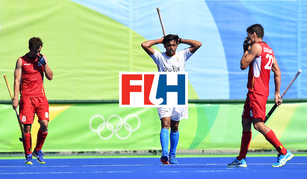 India's Harmanpreet Singh (C) gestures after Belgium's third goal during the men's quarterfinal field hockey Belgium vs India match of the Rio 2016 Olympics Games at the Olympic Hockey Centre in Rio de Janeiro on August 14, 2016. / AFP / MANAN VATSYAYANA        (Photo credit should read MANAN VATSYAYANA/AFP/Getty Images)