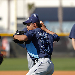 February 20, 2011; Port Charlotte, FL, USA; Tampa Bay Rays starting pitcher Chris Archer (35) throws in a drill as teammates watch during spring training at Charlotte Sports Park.  Mandatory Credit: Derick E. Hingle