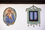 Window detail of traditional old 18th Century Tyrolean house built 1787 in the town of Oetz in the Tyrol, Austria
