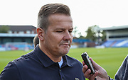Forest Green Rovers manager, Mark Cooper being interviewed before the match during the EFL Sky Bet League 2 match between Macclesfield Town and Forest Green Rovers at Moss Rose, Macclesfield, United Kingdom on 29 September 2018.