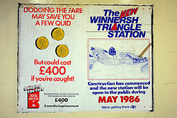 © Licensed to London News Pictures. 03/12/2011, London, UK. A poster informing passengers who doge rail fares that they may incur a 400GBP fine or three three months imprisonment. Next to a poster informing passengers of the new Winnerish Station. Staff working at Richmond Station in London have uncovered railway posters from the late 1980's whilst upgrading poster holders. Photo credit : Stephen Simpson/LNP