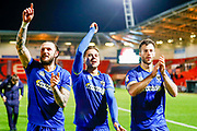 AFC Wimbledon defender Callum Kennedy (23) , AFC Wimbledon midfielder Harry Forrester (11), on loan from Rangers,  and AFC Wimbledon defender Jonathan Meades (3) all celebrate AFC Wimbledon staying in League One  during the EFL Sky Bet League 1 match between Doncaster Rovers and AFC Wimbledon at the Keepmoat Stadium, Doncaster, England on 1 May 2018. Picture by Simon Davies.