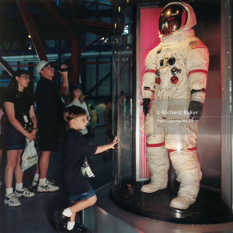 NASA technology.Boy admires an Apollo moon suit.A boy visitor looks at an Apollo moon suit at the Kennedy Space Center museum dedicated to NASA's achievements. It is over 30 years since man last set foot on the moon but, for many Americans, the romance of space travel is more powerful than ever.