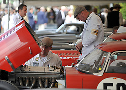 © Licensed to London News Pictures. 17/09/2011. GOODWOOD, UK. Mechanics work on cars. The Goodwood Revival at Goodwood in West Sussex today (17 September 2011). The revival is the world's largest historic motor race meeting, which relieves the 'glorious' days of the race circuit. Competitors and enthusiasts all dress in period fashion to enhance the experience. Photo credit : Stephen Simpson/LNP