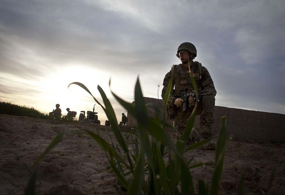 British soldiers of 16 Air Assault Bde's elite BRF (Brigade Reconnaissance Force) move from compound to compound searching for weapons and explosives as part of an operation in the Western Dasht, Helmand Province, Southern Afghanistan on the 18th of March 2011.