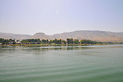 Kibbutz Ginosar on the shores of lake Kinneret as seen from within the lake. Sea of Galilee, Israel