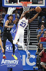 November 14, 2018 - Orlando, FL, USA - The Philadelphia 76ers' Jimmy Butler (23) scors past the Orlando Magic's Wes Iwundu (25) at the Amway Center in Orlando, Fla., on Wednesday, Nov. 14, 2018. (Credit Image: © Stephen M. Dowell/Orlando Sentinel/TNS via ZUMA Wire)