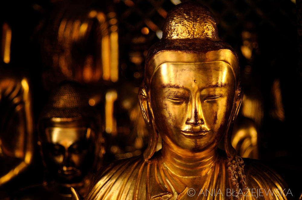 Burma/Myanmar, Yangon. Buddha statue in Shwedagon Paya - the gold temple in Yangon.