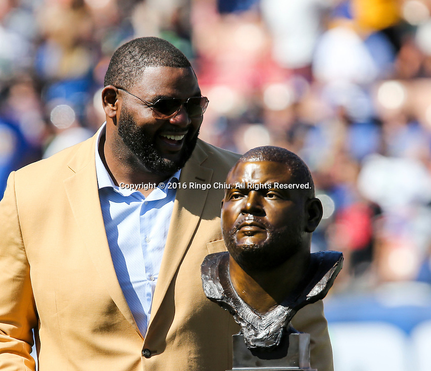 Former Rams team member Orlando Pace looks at his bust during the Rams Hall of Fame Ring of Excellence ceremony at halftime of an NFL football game between the Rams and the Seattle Seahawks at the Los Angeles Memorial Coliseum, Sunday, Sept. 18, 2016, in Los Angeles.(Photo by Ringo Chiu/PHOTOFORMULA.com)<br /> <br /> Usage Notes: This content is intended for editorial use only. For other uses, additional clearances may be required.