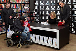 © Licensed to London News Pictures. 24/11/2011. London, UK. Academy Award-winning actress Goldie Hawn meets baby Tyler (14 months) and mother Donna in the Piccadilly branch of Waterstones during a book signing for her new book, 10 Mindful Minutes, which was released on March 1st. : James Gourley/LNP