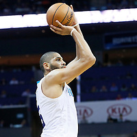 03 November 2015: Charlotte Hornets forward Nicolas Batum (5) takes a jump shot during the Charlotte Hornets  130-105 victory over the Chicago Bulls, at the Time Warner Cable Arena, in Charlotte, North Carolina, USA.