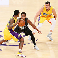 15 November 2016: Los Angeles Lakers guard Louis Williams (23) looks to pass the ball to Los Angeles Lakers forward Larry Nance Jr. (7) over Brooklyn Nets guard Yogi Ferrell (10) during the LA Lakers 125-118 victory over the Brooklyn Nets, at the Staples Center, Los Angeles, California, USA.