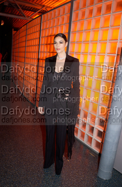 Monica Bellucci, Party to celebrate 100 years of the Santos  de Cartier watch. Le Bourget airport. Paris. 7 April 2004. ONE TIME USE ONLY - DO NOT ARCHIVE  © Copyright Photograph by Dafydd Jones 66 Stockwell Park Rd. London SW9 0DA Tel 020 7733 0108 www.dafjones.com