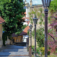 Narrow Cobblestone Walkway in Eger, Hungary<br /> Most guide books about Eger focus on its famous architecture and history. Few talk about one of old town&rsquo;s most charming features: the narrow cobbled streets and walkways. Reserve time to stroll and explore these delightful passages away from most tourists. If you need a breather, take a seat on a nearby bench and savor the ambiance.
