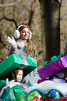 NEW YORK, NY, USA, Nov. 28, 2013. Ariana Grande waves from a float in the 87th Annual Macy's Thanksgiving Day Parade.