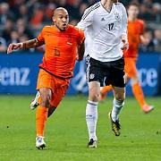 NLD/Amsterdam/20121114 - Vriendschappelijk duel Nederland - Duitsland, Nigel de Jong in duel met Per Mertesacker