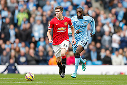 Paddy McNair of Manchester United is challenged by Yaya Toure of Manchester City - Photo mandatory by-line: Rogan Thomson/JMP - 07966 386802 - 02/11/2014 - SPORT - FOOTBALL - Manchester, England - Etihad Stadium - Manchester City v Manchester United - Barclays Premier League.