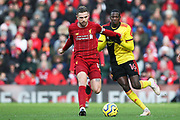 Liverpool midfielder Jordan Henderson (14) and Watford midfielder Abdoulaye Doucoure (16)  during the Premier League match between Liverpool and Watford at Anfield, Liverpool, England on 14 December 2019.