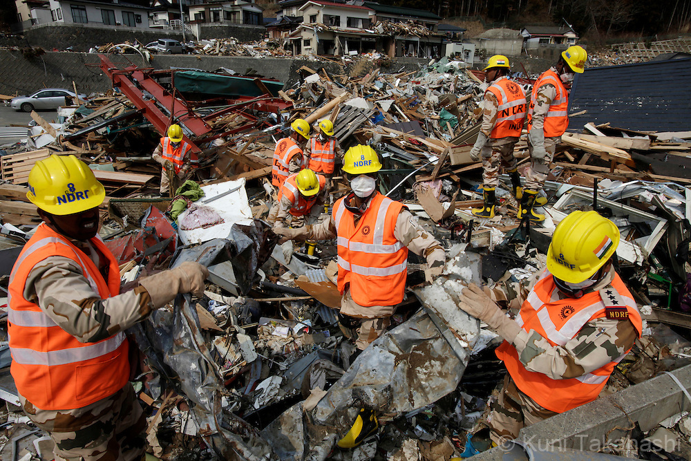 Members of National Disaster Relief Force (NDRF) of India search bodies in Onagawa, Miyagi, Japan on April 2, 2011 after massive earthquake and tsunami hit northern Japan. More than 20,000 were killed by the disaster on March 11. Forty six members of NDRF were deployed to Japan to help discovery effort. .Photo by Kuni Takahashi