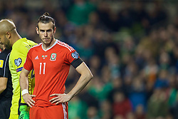 DUBLIN, REPUBLIC OF IRELAND - Friday, March 24, 2017: Wales' Gareth Bale looks dejected after being shown a yellow card, ruling him out of the next fixture, during the 2018 FIFA World Cup Qualifying Group D match against Republic of Ireland at the Aviva Stadium. (Pic by David Rawcliffe/Propaganda)